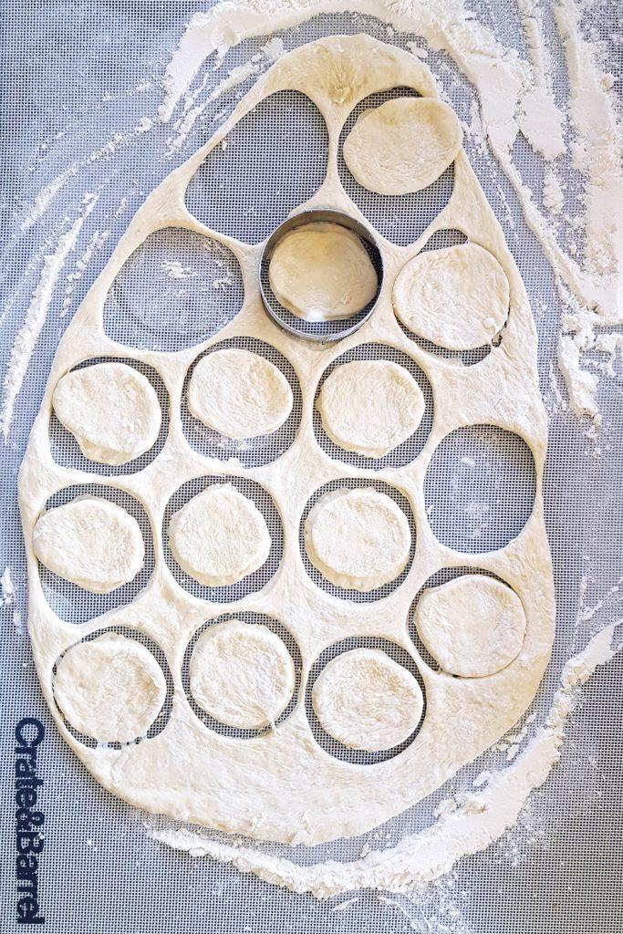 Preparing the dough for Mini Prosciutto, Olive, & Fennel Pizza Bites. | FeastInThyme.com