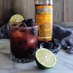 A Midsummer's Heat is a Spicy Blackberry Bourbon Smash Cocktail made with fresh fruit, tart lime juice, and the award-winning Caged Heat Cocktail Syrup! #cocktails #craftcocktails #mixology #homebar #entertaining #signaturedrink | FeastInThyme.com