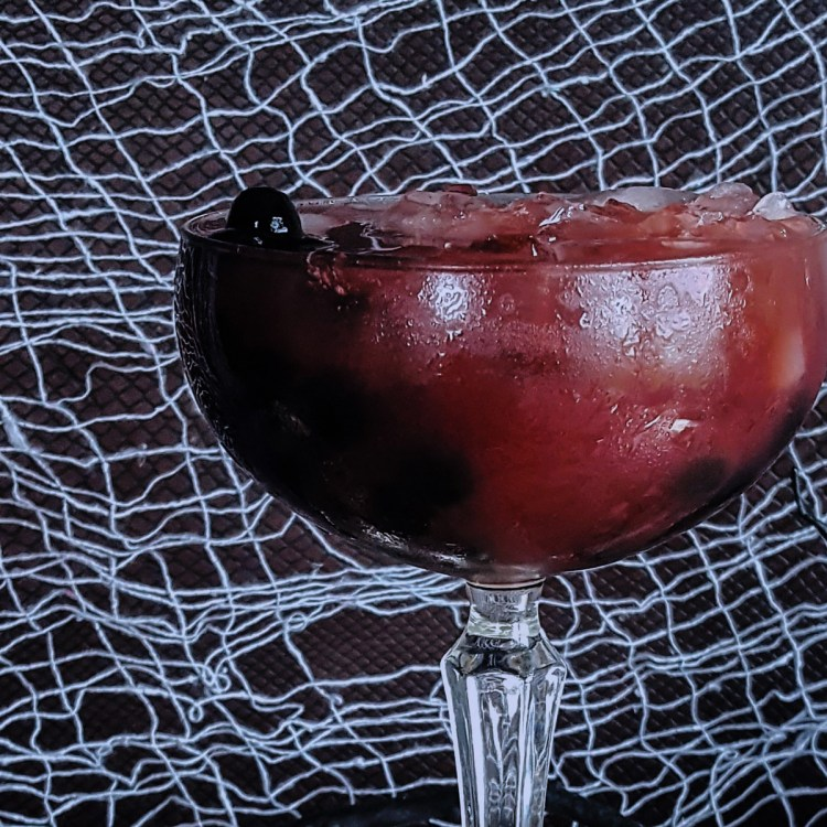 "Celebrate Halloween in style with a delicious pitcher of Under the Scarlet Sea Bourbon Pomegranate Punch. The delicate flavors of Earl Grey infused bourbon, tart pomegranate, & sweet raspberry liquor are garnished with black tapioca pearl ""caviar"" for a disturbingly sophisticated large batch cocktail. #halloween #spooky #creepy #cocktail #bourbon 