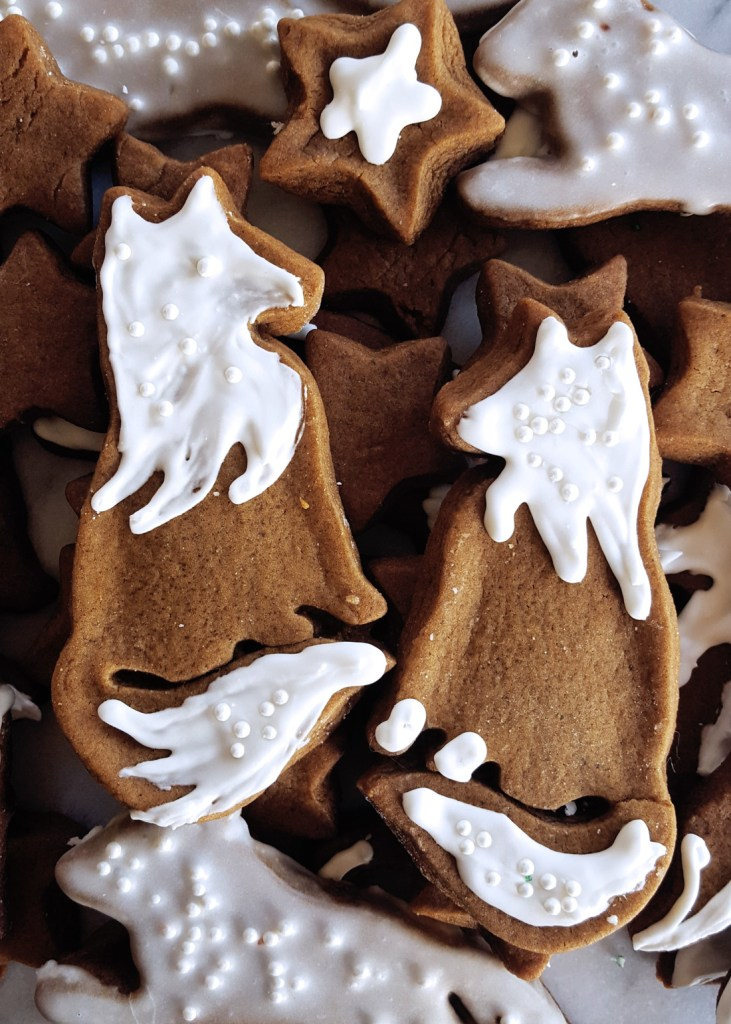 A piles of gingerbread cookie foxes, with two pretty ones