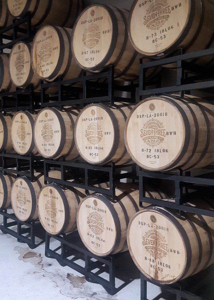 A wall of branded barrels.