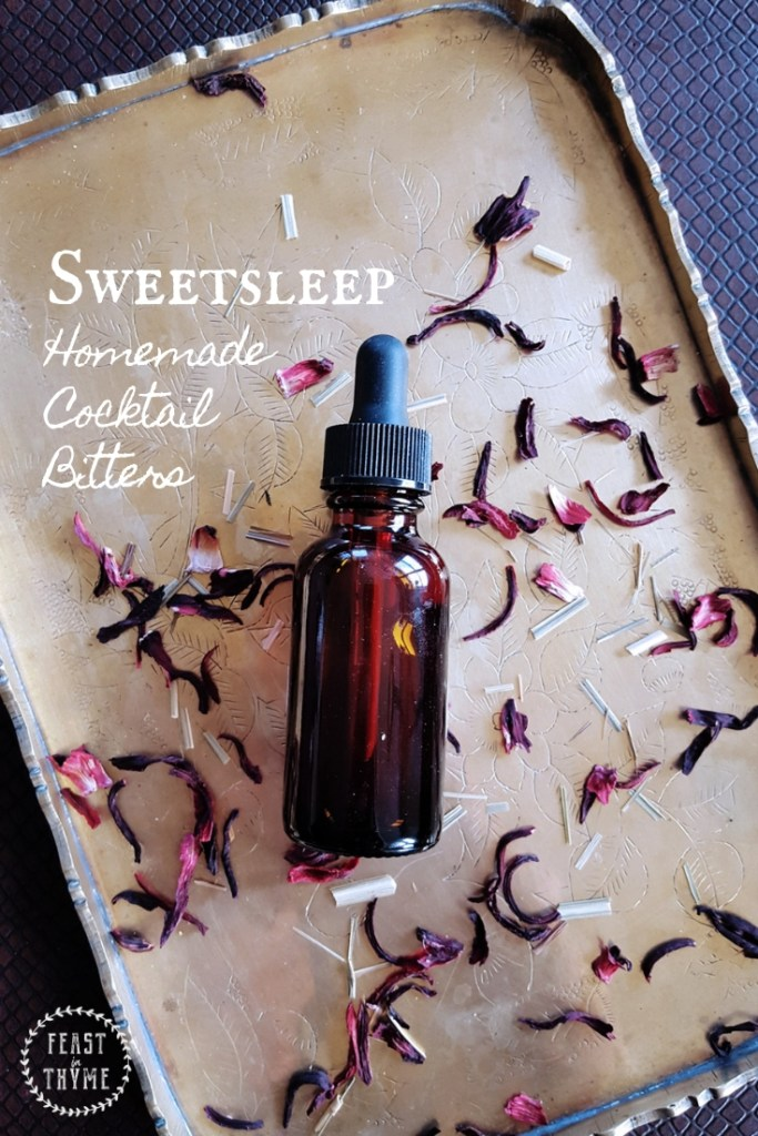 Sweetsleep-inspired bitters bottle, surrounded by lemongrass and hibiscus.