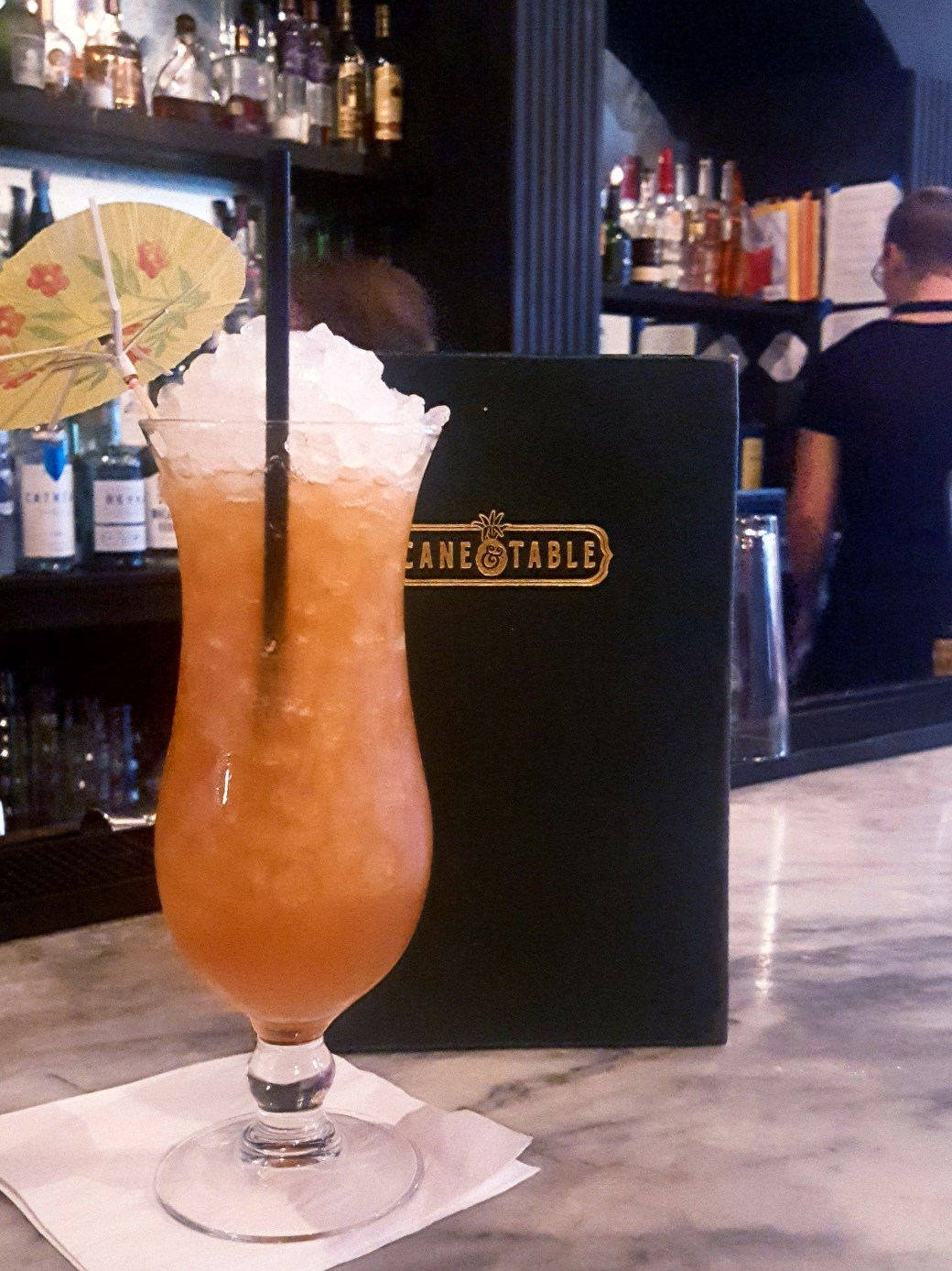 A professionally made Hurricane cocktail paired with the menu from Cane & Table.