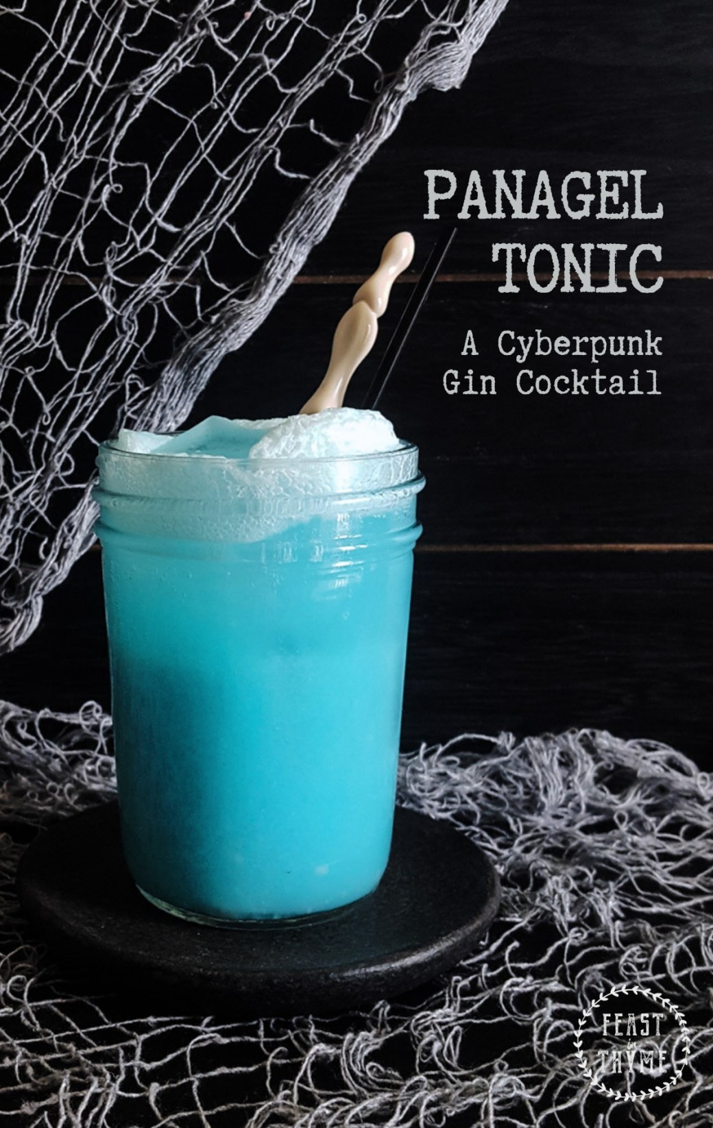 Sweet, sparkling, and outlandishly blue, the PanaGEL Tonic is the perfect gin cocktail for your next post-apocalyptic adventure. #cyberpunk #cocktail #harshrpg | FeastInThyme.com