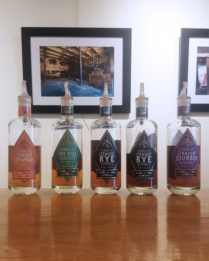 A line-up of Painted Stave whiskeys.