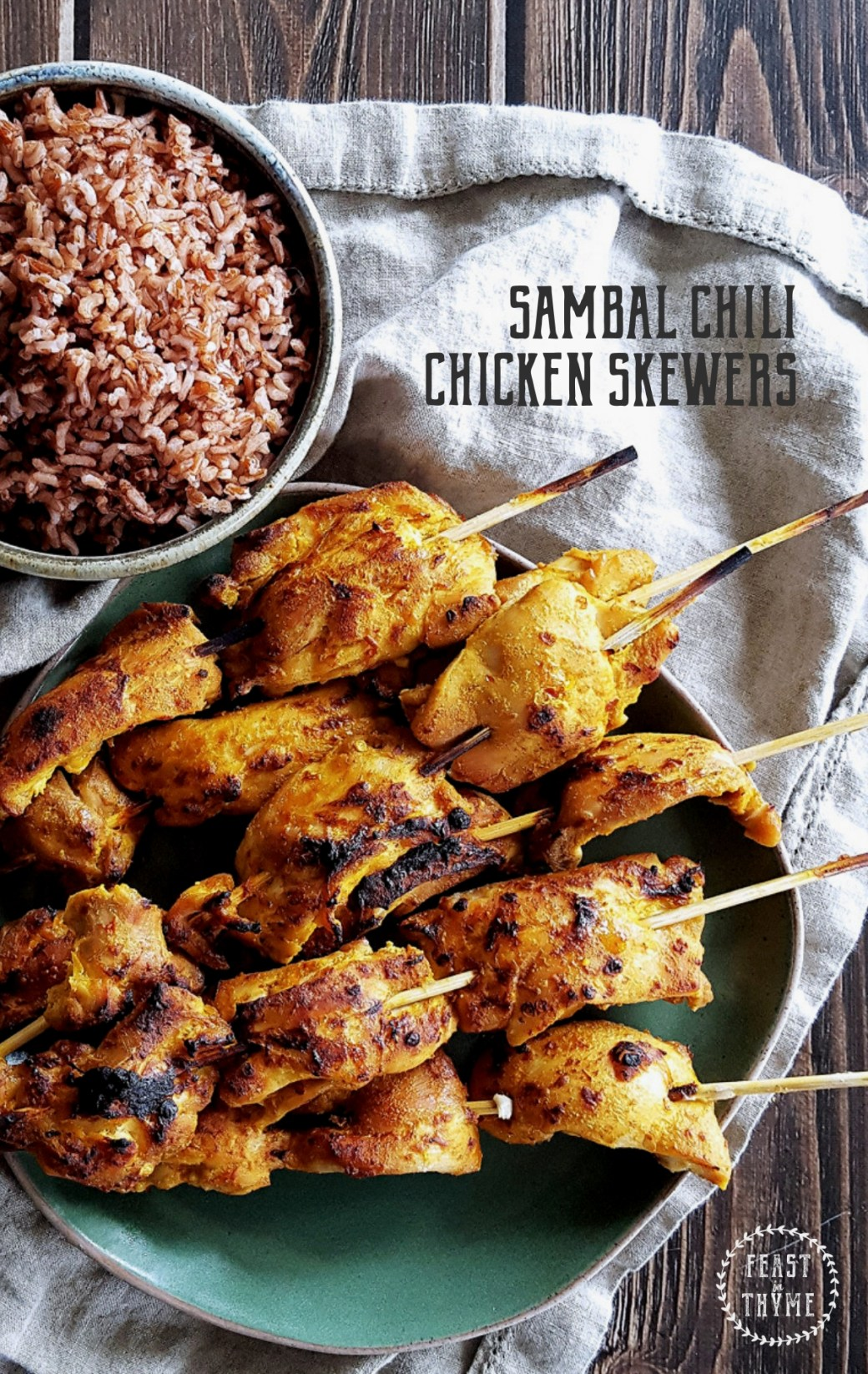 Enjoy a sweet and spicy oven-roasted dinner with these quick and easy marinated Sambal Chili Chicken Skewers. #spicy #weeknightdinner #chickendinner | FeastInThyme.com