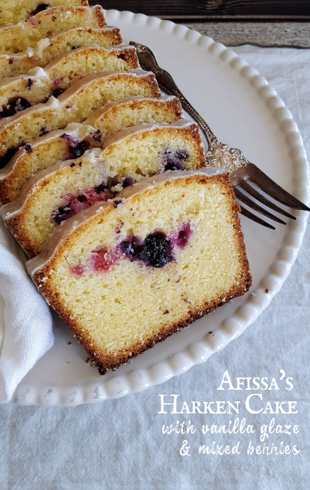 Light yellow sponge and vanilla glaze surround bites of mixed berries in this delightfully simple Harken Cake recipe inspired by Carnival Row. #harkencake #carnivalrow #steampunk #victorian | FeastInThyme.com
