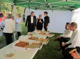 Volunteers enjoy pizza before they start work