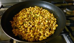 nuts spread out in the pan