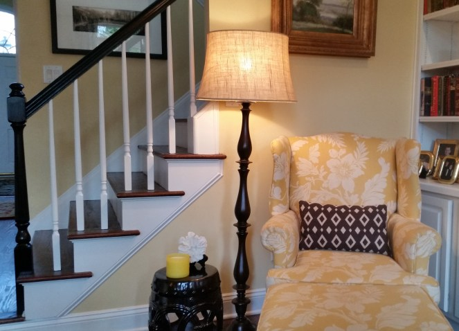 Yellow floral print wing chair --Why My Family Room Decor Is Always A Work In Progress