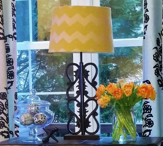 By adding a few light and bright elements, like a yellow lampshade or a vase of tulips, you can easily style your home for Spring --Spring Has Sprung A Spring Home Tour