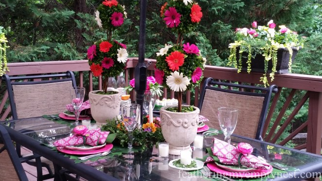 Boxwood and summer blooms take center stage in a Romantic Flower-themed Summer Tablescape