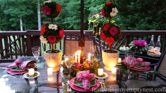 Candles and flowers provide the romance to a Romantic Flower-themed Summer Tablescape