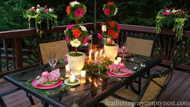 Candlelight adds the final romantic element to the Romantic Flower-themed Summer Tablescape.