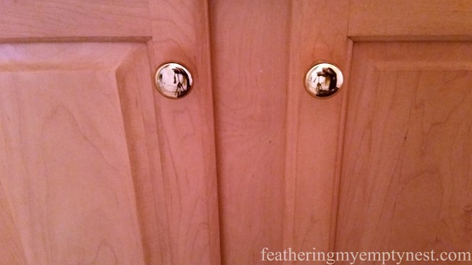 Original natural finish maple cabinets with little brass button knobs-Inexpensive Kitchen Updates An Camouflage.
