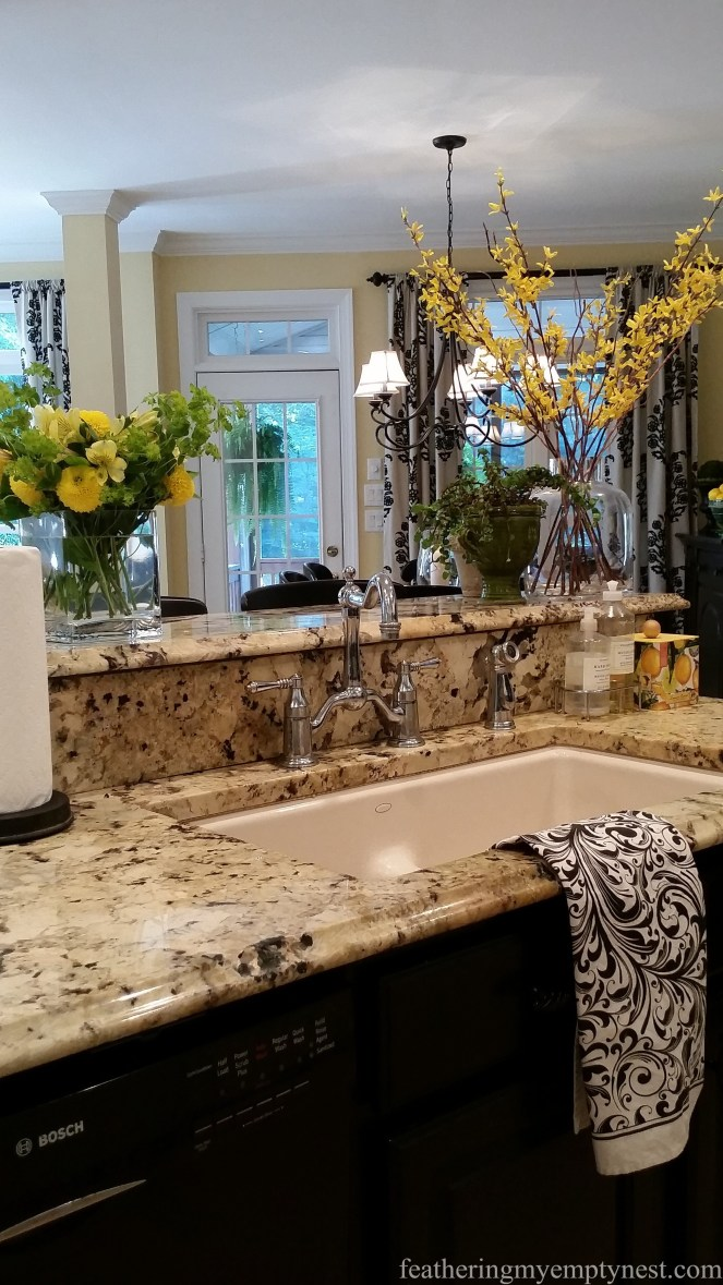 Cream under-mount sink with nickel faucet--Inexpensive Kitchen Updates And Camouflage