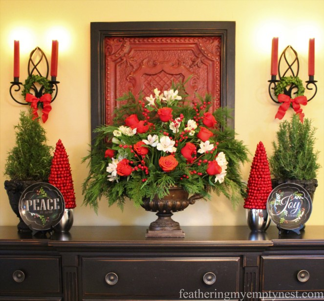 Breakfast room buffet styled for Christmas with old dripping candle sconces and framed red ceiling tile --Tips For Using Chalk Paint And Dark Wax