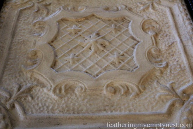 Chalk painted Victorian tin ceiling tile after the application of dark wax --Tips For Using Chalk Paint And Dark Wax