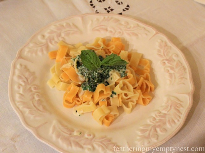 Heart-shaped pasta served with a herb cream sauce --How To Use The Language Of Flowers To Create A Blooming Valentine's Dinner
