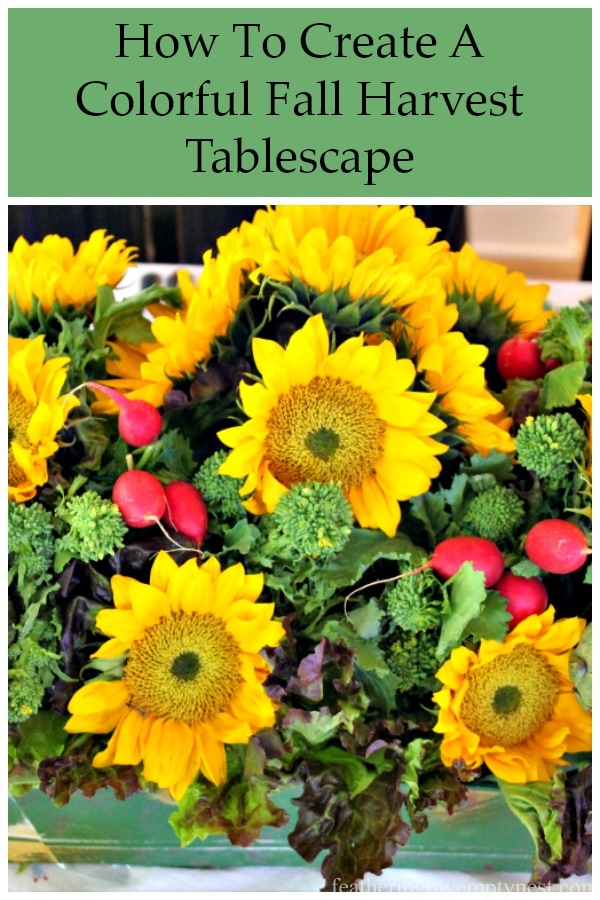 How to create a fun and colorful fall harvest tablescape with a centerpiece of sunflowers and fresh garden vegetables that will charm your guests. #falltablescape, #falldecor, #fallcenterpieces