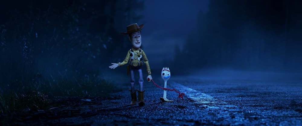 Toy Story 4 Woody and Forky walking along the road