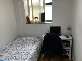 My room: bed, desk, window, fridge, wardrobe, floor heating & ac unit, private bathroom with a toilet and shower.