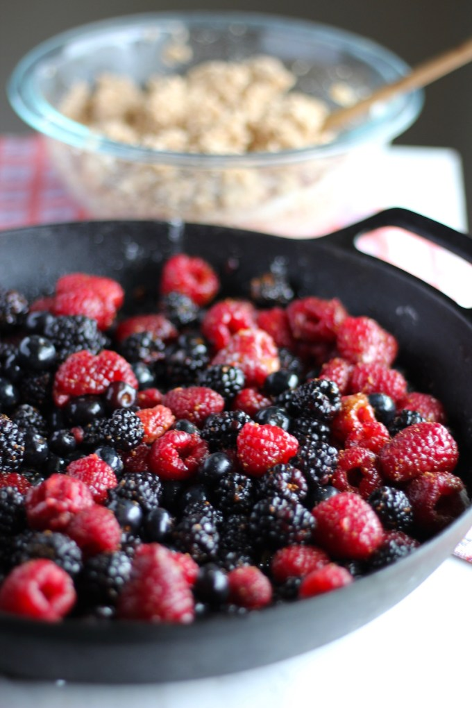 Skillet Berry Cobbler - a vegan, paleo dessert that my family LOVES since it's full of fresh berries, soft, cinnamon & sugar biscuits! | fedandfulfilled.com