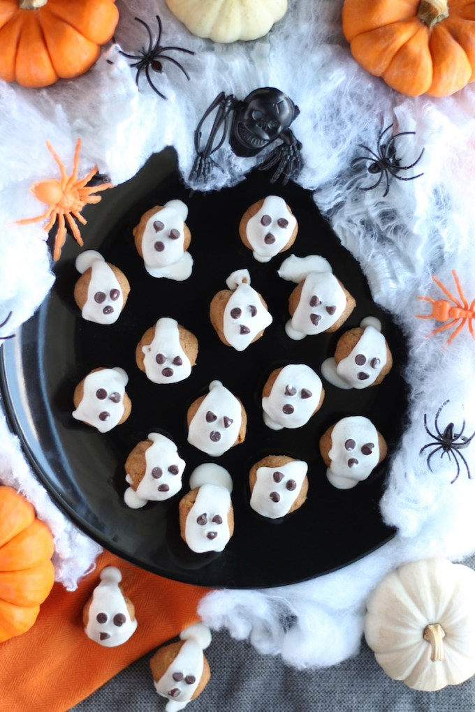 "Almond Butter ""Boo"" Bites - these paleo spooky snacks are loaded with almond butter, pumpkin, cinnamon, honey, and topped with coconut butter and chocolate chips ""ghosts!"" 