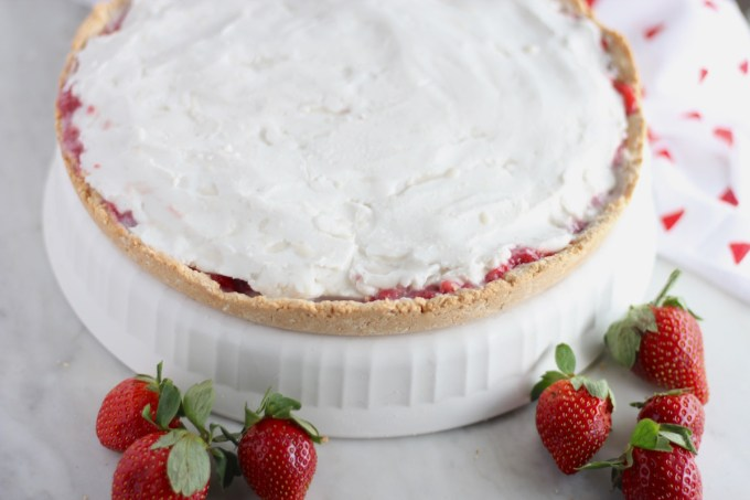 Paleo Strawberries and Cream Tart (AIP) - a decadent, yet healthy dessert for any special occasion! Fresh strawberries, coconut cream, and a crisp cookie crust make this tart to die for! | fedandfulfilled.com