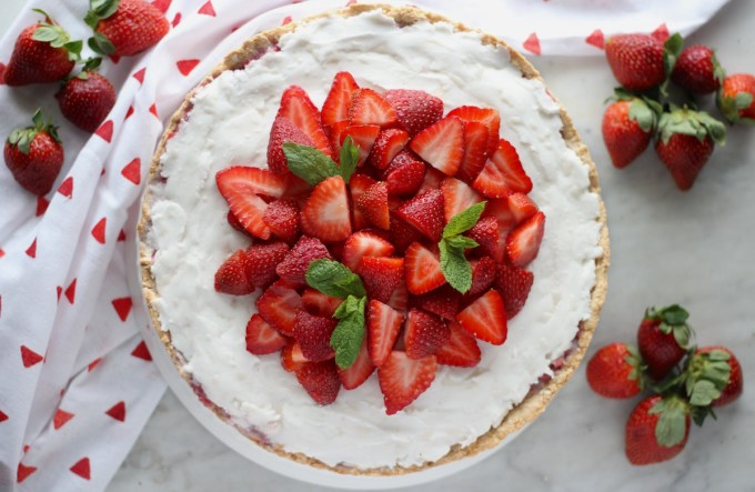Paleo Strawberries and Cream Tart (AIP, Vegan) - a show-stopping strawberry tart made with fresh berries, whipped coconut cream, and a crispy coconut cookie crust! YUM! | fedandfulfilled.com