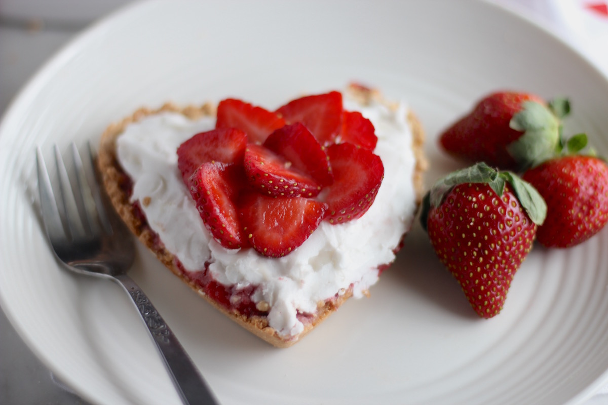 Paleo Strawberries and Cream Tart (AIP, Vegan) - an elegant yet easy-to-make dessert featuring fresh strawberries, coconut whipped cream, and a delicious coconut cookie shortbread crust! | fedandfulfilled.com