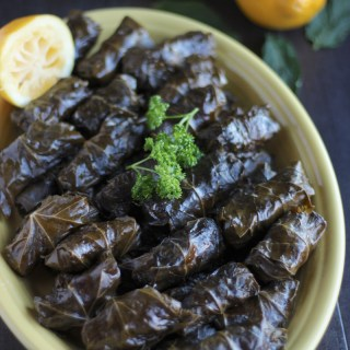 Instant Pot Paleo Stuffed Grape Leaves (AIP) - succulent grape leaves are stuffed with grass-fed beef, cauliflower rice, golden raisins, fresh mint, and Middle Easter spices! So delicious and easy in the Instant Pot! | fedandfulfilled.com