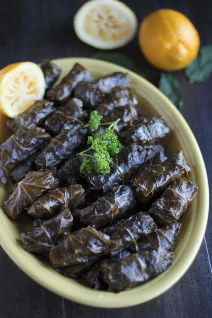 Instant Pot Paleo Stuffed Grape Leaves (AIP) - succulent grape leaves are stuffed with grass-fed beef, cauliflower rice, golden raisins, fresh mint, and Middle Eastern spices! So delicious and easy in the Instant Pot! | fedandfulfilled.com
