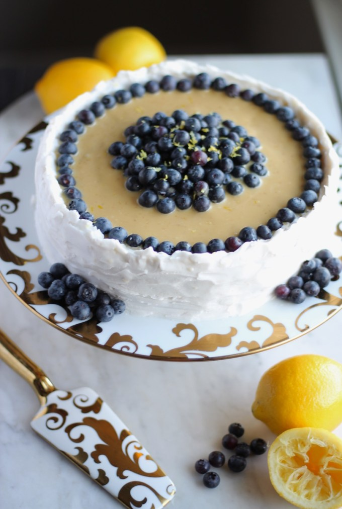Paleo Lemon Blueberry Layer Cake (AIP) - a luscious lemon cake is filled with blueberry compote and topped with lemon cream and whipped coconut frosting! | fedandfulfilled.com