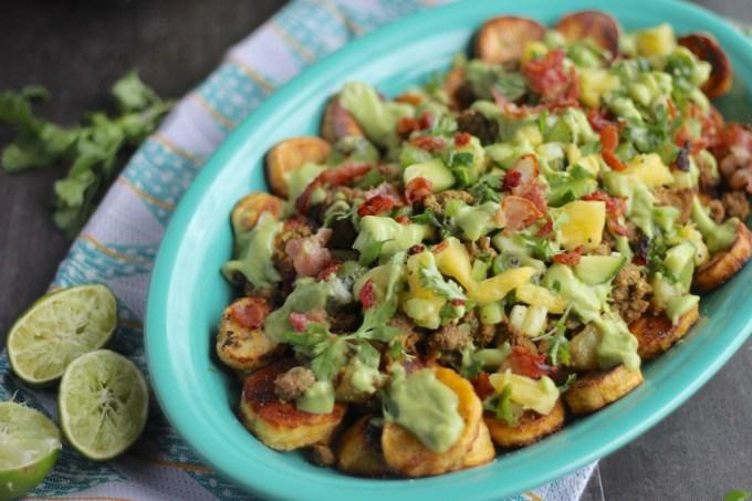 Loaded Tropical Plantain Nachos (AIP, Paleo) - a fresh, no-bake take on nachos! With savory plantains, crispy bacon, pineapple kiwi salsa, and avocado lime crema! | fedandfulfilled.com