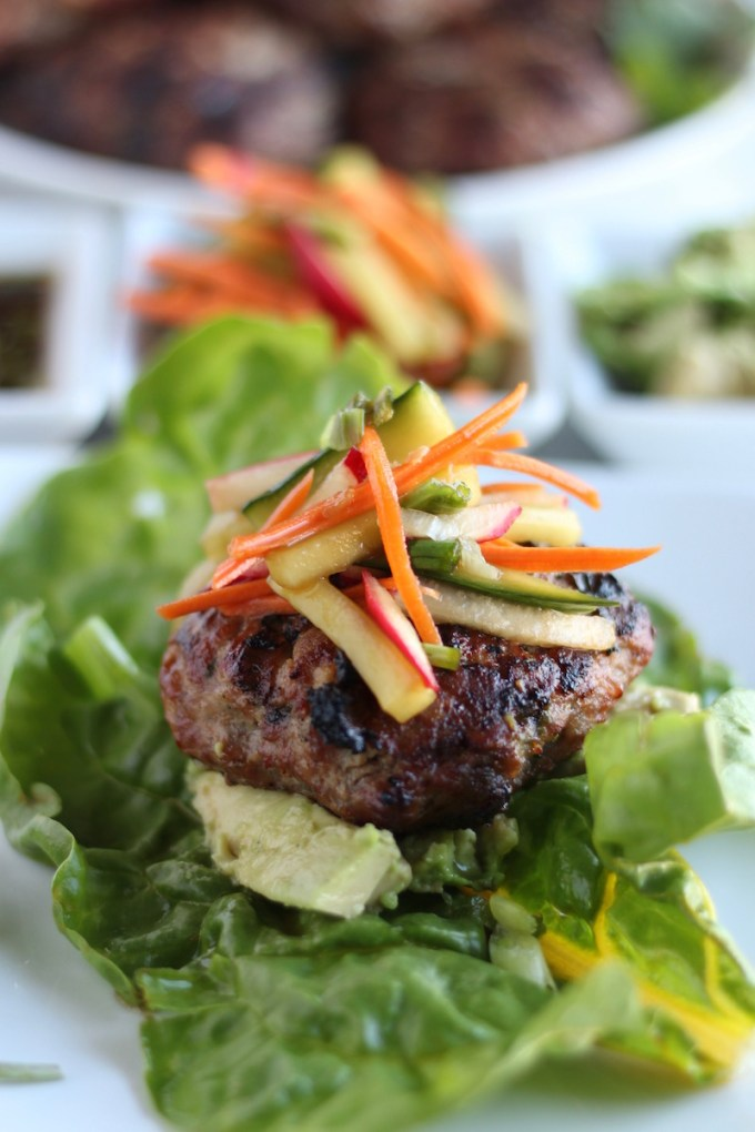 Paleo Pork Banh Mi Burgers (AIP) - these Vietnamese burgers are a flavor explosion from the ginger and basil-infused burgers, the tangy pickled vegetables, and the sweet, salty, sour sauce! Insanely delicious! | fedandfulfilled.com
