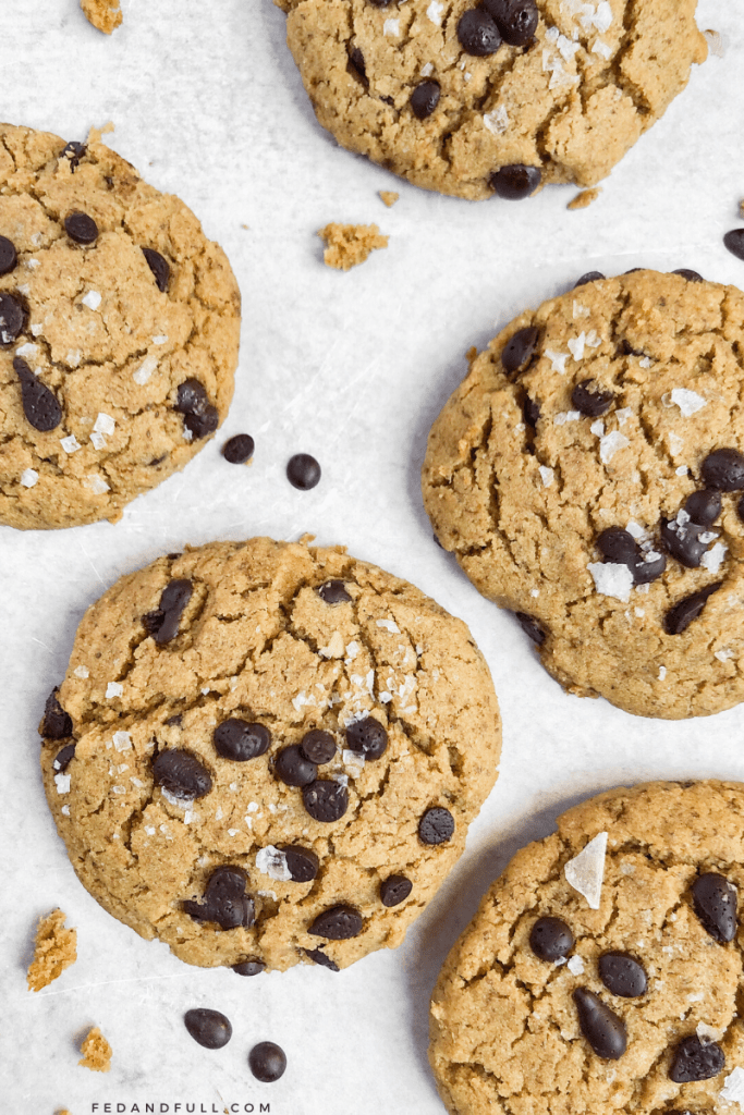 Overhead shot of Tahini Tigernut Chocolate Chip Cookies with sprinkled salt on top