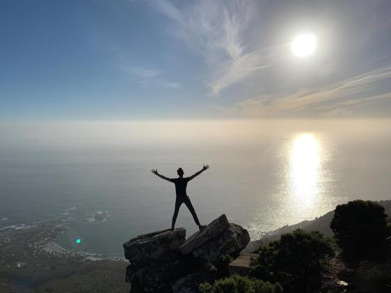 federico pistono with open arms toward the sun in south africa