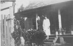 Lewis' home on the river.  Standing on the steps is Addie Jane Hewett with son Howard Curtis Hewett Sr. (my Dad). Photo taken after 1935.