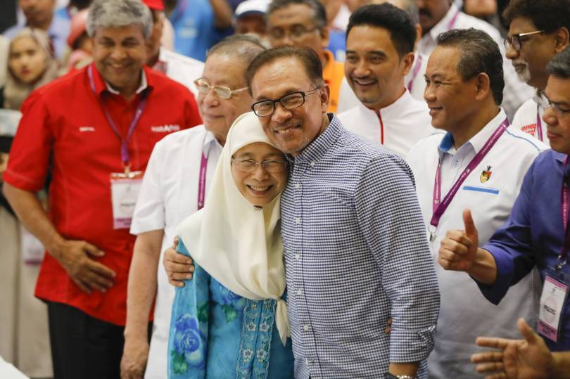 Malaysia Anwar By Election 08850 - The Latest: Malaysia's PM-in-waiting wins landslide victory
