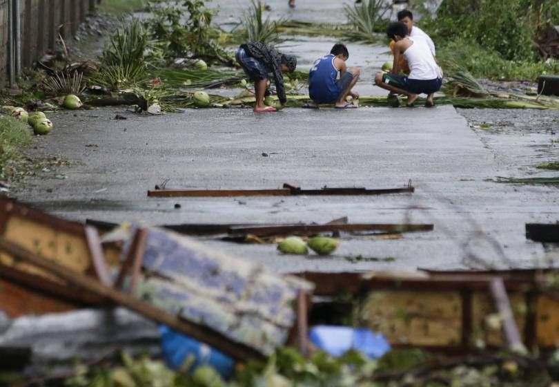 Philippines Asia Typhoon 18372 - The Latest: At least 3 dead as typhoon lashes Philippines