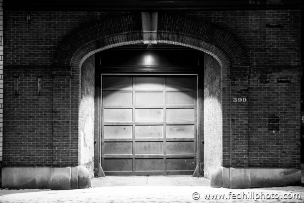 Baltimore, Federal Hill Photography LLC, SKU-4, USA, arch, architecture, black and white, brick, building, door, doorway, entrance, fine art photography, fire station, maryland, monochrome, night, side walk, snow, stock photography, street, urban, wall, winter