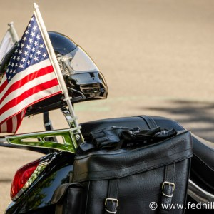 Fine art photograph of a motorcycle seat, motorcycle helmet, and United States flag attached to the seat.