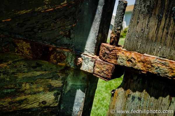 Fine art nautical photo of rust and decay on the rudder and stern of Captain John Smith's shallop, a boat.