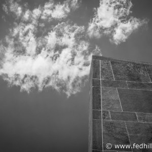 Black and white fine art photo of Oberlin College Hall auditorium wall and clouds and sky in Oberlin, Ohio.