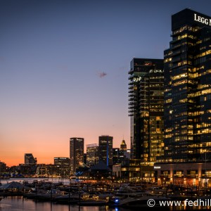 Fine art photograph of sunset over Harbor East and Inner Harbor in Baltimore City, Maryland. Water, marina, and buildings.