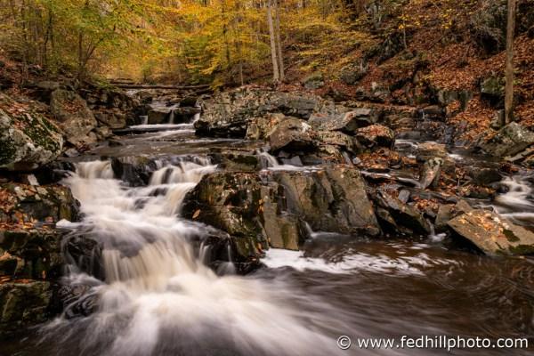 Fine art autumn nature photo of waterfall in Broad Run stream feeding into Gunpowder Falls river.