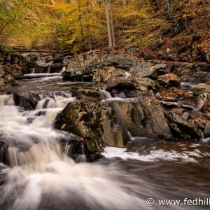Fine art autumn nature photo of waterfall in Broad Run stream feeding into Gunpowder Falls river.
