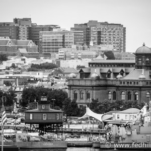 Fine art black and white photo of a lighthouse, Johns Hopkins, MECU Pavilion, and other buildings in Baltimore City, Maryland.