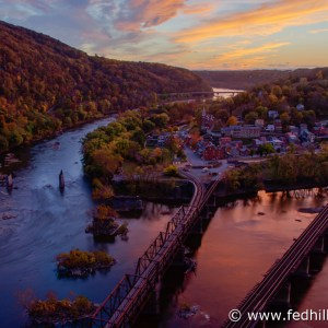 Fine art photo of autumn sunset over Harpers Ferry, railroad bridges, and confluence of Shenandoah and Potomac rivers in WV.